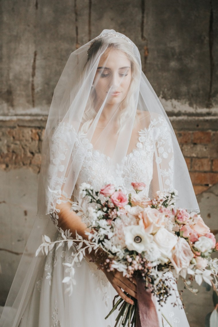 """Two-tier tulle veil with a sweet and simple Swarovski crystal detail from White Lily Couture. """" Image by Mallory Sparkles Photography."""