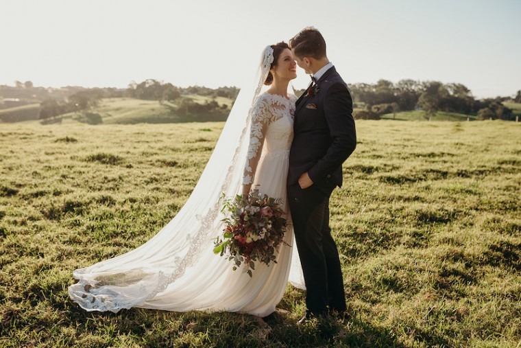 """This bride wears a Mantilla Cathedral-length veil. """"Remember the wind - mostly if you are getting married on the beach! Positioning yourself against the wind is very important!"""" Valentina Pintus - Sunshine Brides, image by Tenielle Fink Photography"""